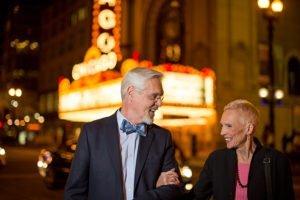 senior couple outside chicago theater