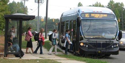 people boarding a public transportation bus